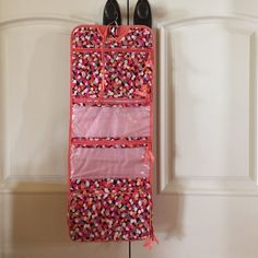 Vera Bradley Hanging Organizer in Pixie Confetti Vera Bradley Hanging Organizer in Pixie Confetti. This is new with tags. This was bought to match my other pieces in this collection, but I haven't used it. Vera Bradley Bags Cosmetic Bags & Cases