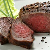 Pepper-crusted ostrich fillet Recipe (serves Serve with potato wedges, Irish cut potato chips, or potato skins, and blanched or roast veggies. Venison Recipes, Meat Recipes, Game Recipes, Chicken Recipes, Recipies, Ostrich Meat, Fish And Meat, Potato Skins, Man Food