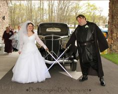 Star Wars Wedding. Anakin Skywalker Costume. Star Wars Theme. Bride and Groom with Lightsabers. Classic Car. Lace Sleeves. Wedding Photos. South Jersey Photographer.