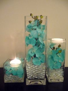 Are you thinking about having your wedding by the beach? Are you wondering the best beach wedding flowers to celebrate your union? Here are some of the best ideas for beach wedding flowers you should consider. Wedding Centerpieces, Wedding Table, Wedding Reception, Wedding Decorations, Quince Decorations, Centerpiece Ideas, Orchid Centerpieces, Turquoise Centerpieces, Table Decorations