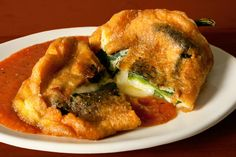 Chiles Rellenos by Chow. This classic Mexican chiles rellenos recipe (sometimes spelled chili relleno) is filled with lots of cheese and served with a spicy roasted tomato salsa. Mexican Cooking, Mexican Food Recipes, Ethnic Recipes, Chili Recipes, Salvadorian Food, Chili Relleno, Chiles Rellenos Recipe, Chile Relleno Sauce, Comida Latina