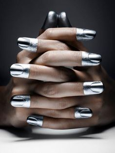Silver-dipped tips. Cool, but I think you got a little bit on the skin. Maybe she let her kids paint her nails.