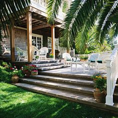 Deck with wide stone steps down to the grass. Love this!!