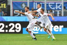 """Palermo's defender from Italy Andrea Rispoli (L) celebrates after scoring a goal with Palermo's midfielder Illija Nestorovski and Palermo's defender from Italy Roberto Vitiello (R) during the Italian Serie A football match Inter Milan vs Palermo at """"San Siro"""" stadium in Milan on August 28, 2016.   / AFP / GIUSEPPE CACACE"""