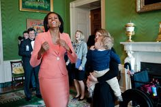 First Lady Michelle Obama laughs while visiting with Brianna Mast, wife of Wounded…