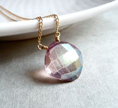 Add some shine with a shimmering pink quartz pendant.