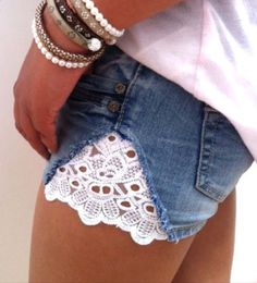 Lace shorts DIY STYLE SUPER EASY: Take shorts cut along side seam, Cut lace in 4-6 inch rounded triangle shape, Attach and Sew from the inside. Voila