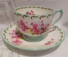 Vintage SHELLEY Fine Bone China Tea Cup & Saucer - pink blossoms c.1940-1966    White with floral design on the saucer, inside and outside the cup.
