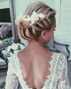 french braided updo wedding hairstyle with chic white flower hairpiece via ulyana aster  / http://www.himisspuff.com/top-100-wedding-dresses-2017-from-top-designers/3/