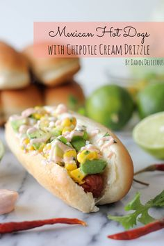 Mexican Hot Dogs with Chipotle Cream Drizzle   •2 cups corn kernels   •1/4 cup diced red onion   •2 tablespoons chopped fresh cilantro leaves   •2 tablespoons freshly squeezed lime juice   •Pinch of salt   •1 avocado, halved, seeded, peeled and diced   •6 Hebrew National Hot Dogs   •6 hot dog buns   •1/4 cup Greek yogurt   •1 teaspoon chipotle peppers in adobo sauce, or more to taste