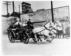 Firefighter Charles Gregory (right) drove one of the Indianapolis Fire Department's Ahrens steam engines, housed at the old No. 6 station, on a simulated fire run down West Washington Street near Blackford Street in 1911. Riding in the back was engineer John Stake. In 1921, the department was completely motorized.