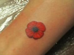 thinking of getting two small poppy tattoos behind each ear, one for my Great Grandfather and my Great Uncle