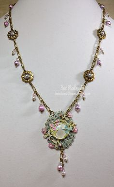 Finished Up Friday-Bird charm and flower filigree necklace.  The bird charm, flower filigree pieces and Spectra beads are from B'sue.  Painted with a flat white and added color with acrylics and then sealed with crystal clear Krylon.