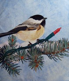 """""""Christmas Chickadee"""" hand appliqued and machine quilted . . . by David Taylor . . .  there are 409 individually appliqued pine needles and . . . the mini tree light bulb is spectacular . . ."""