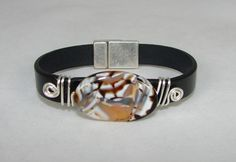SOLD Flat leather bracelet with shades of brown, tan & white agate focal, fine silver swirls & magnetic clasp