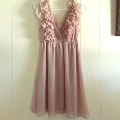 Rose beige dress It is a beautiful rose nude dress with a v-neck surrounded by ruffles. Worn once Ya Los Angeles Dresses Wedding