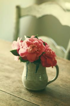 A ceramic creamer makes for a charming flower vessel.