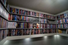 Amazing Built in DVD shelves... I would LOVE this for the media room!