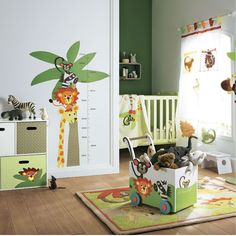 A contemporary jungle safari baby's nursery. It's a perfect theme for theme for a little boy. The look has been achieved by coordinating jungle bedding, cot mobile and decor accessories. The mobile storage chest keeps clutter at bay. The white furniture suite harmonises the overall style. [1] http://www.babydeco.co.uk/jungle-safari-nursery/hideseek/