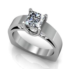This stunning engagement ring showcases one princess cut center diamond, held in place by U-shaped prongs that also serve to subtly show off ten round accent diamonds. These accent diamonds are visible from a side profile of the ring, and have a total carat weight of 0.3cts. They are G-I colour and SI1-SI2 clarity. This polished, 4.0mm wide band is shown here with a 1.0ct princess cut center diamond. See details for other center diamond shapes and sizes.