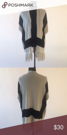 Sleeveless Sweater Sleeveless sweater with fringe trim. Color is beige/cream with black. MAKE ME AN OFFER! Forever 21 Sweaters Shrugs & Ponchos