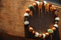 "Mermaid Treasures (single sz L) $3 This pair of bracelets are made with a mix of ceramic, Czech, Swarvoski and antiqued brass beads.  Fits 9""-10.5"" wrists (size large). Stretchy band."
