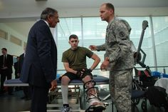 Army Lt. Col. Donald Gajewski, director of the Center for the Intrepid, introduces Defense Secretary Leon E. Panetta to Marine Corps Lance Cpl. Jonathan Stephenson during his tour of the CFI on Fort Sam Houston in San Antonio, June 27, 2012. Panetta spent the day visiting with wounded warriors at the CFI and the San Antonio Military Medical Center, thanking each service member and their families for their service and sacrifice. Photo by Elaine Sanchez