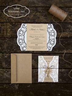Gorgeous rustic wedding invitations printed on Kraft card finished off with rose paper doilies, twine and a wee tag.
