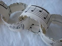 Chain garland made from old sheet music scraps / strips and edges dipped in mica glitter