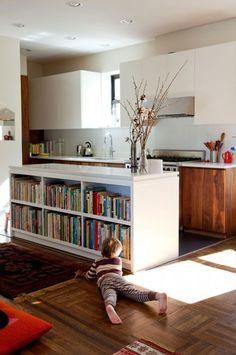 kitchen bar with bookshelves. (via desire to inspire, photo credit jessica antola)