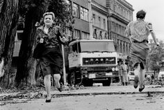 """Sarajevo, 1992 - Women run across area known as """"Snipers Alley"""".  Civil War in Yugoslavia produced many atrocities not seen across Europe since WWII."""
