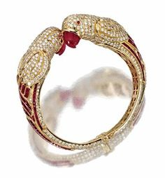 GOLD, RUBY AND DIAMOND 'PARROT' BANGLE-BRACELET