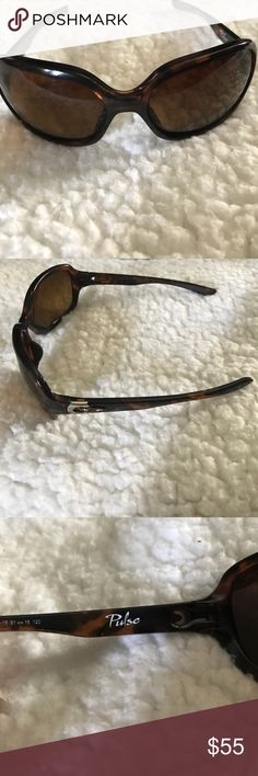 Oakley Pulse Sunglasess Brown tortoise color, pre owned but still in good condition, it has a couple scratches on the left lense very minor and unnoticeable, reason for the price I am selling it, will provide a case or dust bag Oakley Other