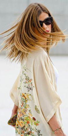 Twirling in a pretty floral kimono.