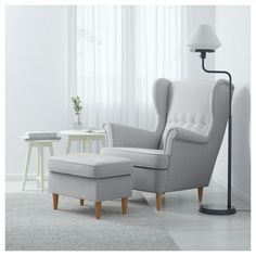 IKEA STRANDMON Wing Chair Skiftebo Light Beige You Can Really Loosen Up And  Relax In Comfort Because The High Back On This Chair Provides Extra Support.