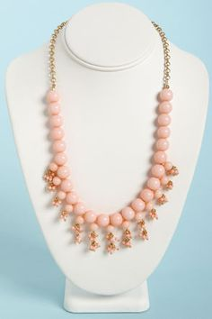 Check it out from Lulus.com! Take your look to the next level with one final flourish from The Finishing Touch Light Pink Bead Necklace! Shiny spherical beads in pale, peachy pink are strung along a golden chain, with a tier of smaller beads below, plus tiny, faceted clusters dangling from beneath for an extra touch of shine. Beads dangle 1.25
