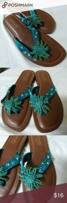 Coconuts by matisse comfortable cushion flip flops Beautiful beaded sandals with a very comfortable cushion.. never worn  as shown in the picture one small scrape on the side. Blue aqua teal green beads. Perfect for summer! Please check out my other items and automatically save 25% when you bundle three or more. Offers are always considered. coconuts by matisse Shoes Sandals
