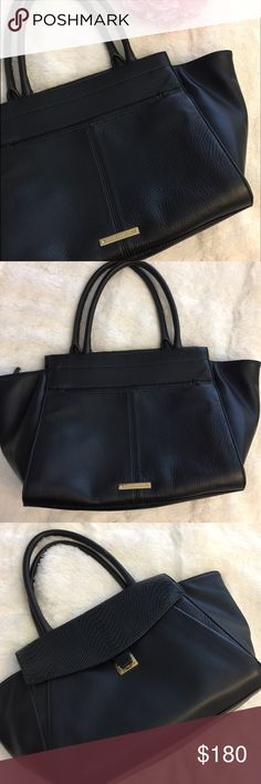 Vince Camuto Lonni Black Leather Satchel Gently used Vince Camuto Lonni Black Leather satchel. Zip closure and front pocket. Slight scuff on the back of the bag (pictured). No dust bag. 78% genuine leather, 22 % polyurethane. No trades, offers welcome. Vince Camuto Bags Satchels