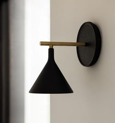 The Cast Sconce Wall Lamp from the Danish design brand, Menu is an extended design idea from the Cast pendants. The Cast collection has been inspired by plumbing weights that masons and carpen Sconces Living Room, Bedroom Sconces, Bedroom Wall Lights, Art Deco Wall Lights, Black Wall Sconce, Black Wall Lights, Plug In Wall Sconce, Bedside Lighting, Wall Mounted Bedside Lights