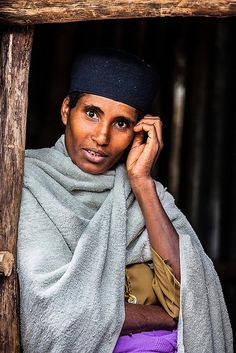 woman priest in the Coptic Orthodox Christian monastery on the island of Lake Tana, Ethiopia by ronnyreportage, via Flickr