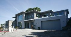 Fana Mur AS - Murhus i Bergen  Liker den store garasjen og gesimsfremspring