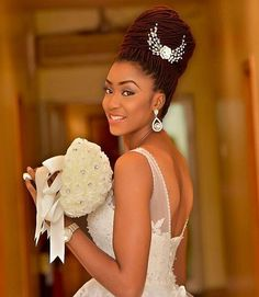 Stunning @stephanyezeani rock this look Faux locs perfectly wrapped into a bun FLAWLESS !!! || Faux locs styled by @tobbiestouch || Makeup by @edens_glam || Dress and accessories by @bridesnmoreikeja || Photography by @klalaphotography #braids #locs #naturalhair #bridalinspiration