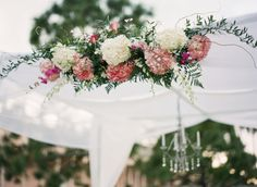white and pinks flower alter decor.