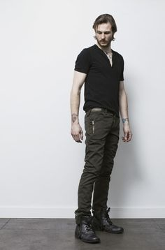 Black cotton s/s vneck henley knit with Olive cotton jacquard button fly trousers with zip details