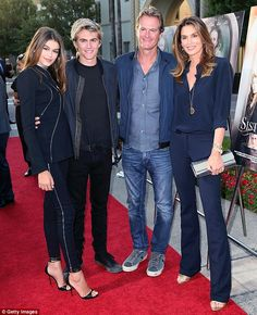 Bubbly in blue: On Wednesday, Kaia Gerber (left) was joined at the Los Angeles premiere of Lifetime's Sister cities by her brother Presley Gerber (second from left), father Rande Gerber (second from right) and supermodel mother Cindy Crawford (right)