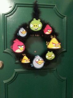 Angry Birds wreath. I made this with a foam ring that I spray painted black, then wrapped feather boas around it and hot glued the angry birds cutouts from that I cut from the angry birds gummy snack boxes.