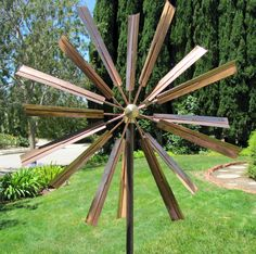 Stanwood Wind Sculpture Kinetic Copper Wind Sculpture, Double Windmill Spinner. Pure copper and brass heavy duty construction. Moves with a slight breeze and always in opposite directions. Wheel diameter 2 ft, height 6 ft. Super strong 4-point pole anchoring. Extremely detailed and impeccable craftsmanship.