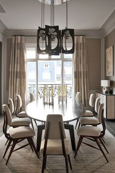 Dining Room - Love those dining chairs & the modern chandelier. DB