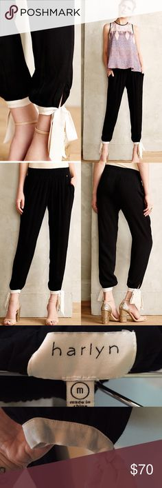 "Anthropologie black ribbon cinched trousers Worn once, very comfy and adorable. Size medium. Smoke-free owner.                        Inspired by her love of classic movies and flea market finds, designer and FIDM grad Maria Stanley launched Harlyn with a quirky risk-taker in mind. We love the color-pop ties on this soft, silky pair; we'd use them as a starting point for shading our accessories. By Harlyn Pull-on styling Polyester, rayon; rayon lining Dry clean Regular: 27""L  10.5"" rise; 8""…"