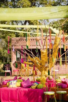 Mehendi Wedding Decor - A colorful mehendi decor, with pink and green seating with yellow genda phool decor Outdoor Wedding Decorations, Wedding Themes, Wedding Tips, Wedding Photos, Indian Wedding Bride, Big Fat Indian Wedding, Indian Weddings, Wedding Story, Dream Wedding